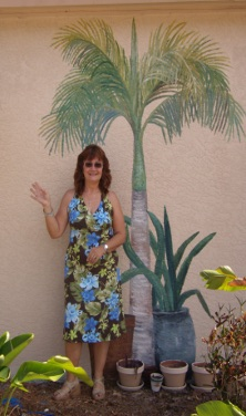 Sherry in front of Trompe L'oeil foliage